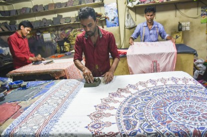 Bangladeshi artisans paint a colourful saree