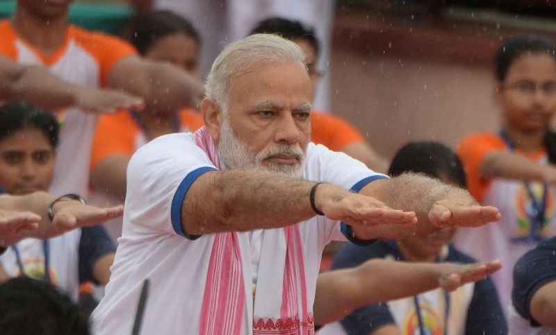 Narendra Modi participates in a mass yoga session