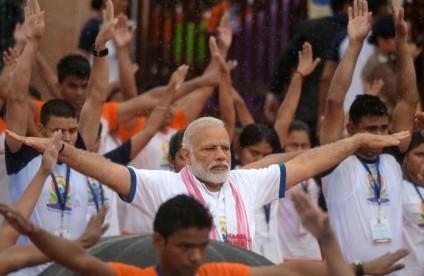 Narendra Modi participates in a mass yoga session