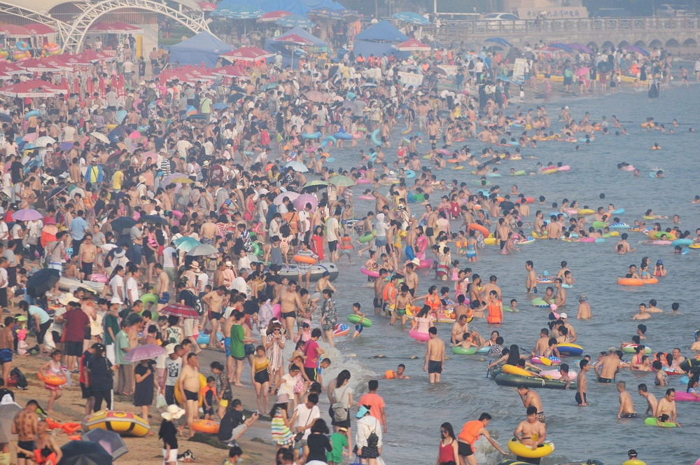 Beachgoers cooling themselves in beach in China