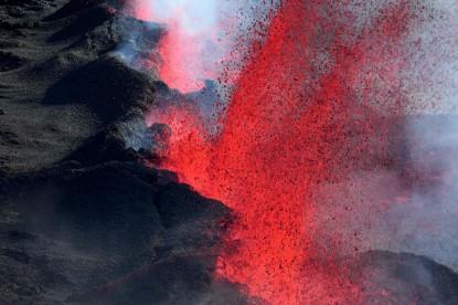 The Piton de la Fournaise erupts lava