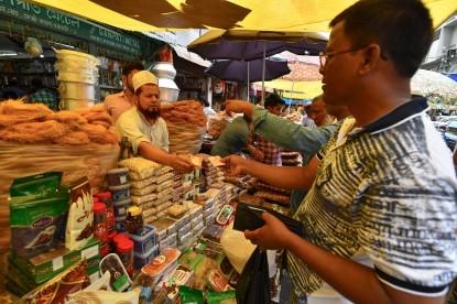 Indian Muslim vendor sells dry food