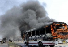 Motorcyclist killed, bus set on fire