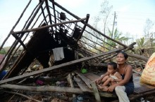 Philippine storm kills 27, but no damage to Manila