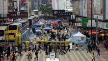 Hong Kong police clear last pro-democracy protest site in retail hub
