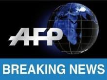 Hostages held inside Sydney Cafe, Islamic Flag held up