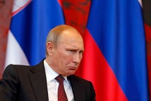 Currency crisis poses Putin his biggest challenge