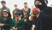 Children, families gather outside school, pray for the dead