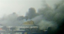 Italy ferry fire: Evacuation hampered by winds
