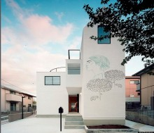 Artist virtually \'paints\' ancient drawings onto modern homes around the world
