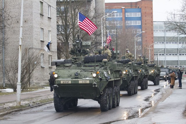 U.S. military vehicles paraded 300 yards from the Russian border