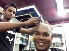 Overjoyed Cricket fanatics get rid of hair, barber happy too!