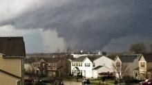 One killed as huge tornado tears through Illinois