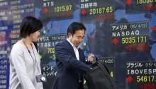 Stocks turn lower after weak global economic surveys