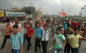 RMG workers block highway for salary at Gazipur
