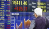 Dollar rises, stocks slip in Asia after Yellen comments