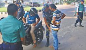 The law enforcers check a motorbike rider