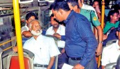 Magistrate speaks to the passengers of a BRTC bus