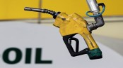 Oil up in Asia but prices under pressure by supply glut