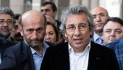 Turkish journalists charged with spying over weapons report