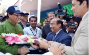 Premier Bank welcomes BB governor with flowers