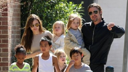 Angie and I were aiming for a dozen, settled for six: Brad Pitt on kids