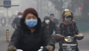 China pollution: First ever red alert in effect in Beijing