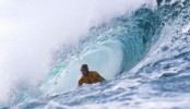 Fanning wins world surf title heat despite brother's death