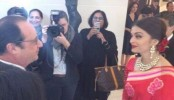 Aishwarya Looks Ravishing in Red Sari for Hollande Lunch