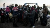Syria civil war: Up to 70,000 refugees head to Turkey, says PM