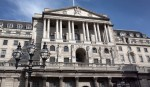 Bank of England cuts UK growth forecasts, holds rates