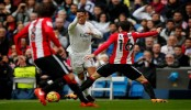 Ronaldo scores 2 for Madrid; 1st league victory for Neville
