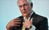 ExxonMobil chief looking for deals amid oil crash