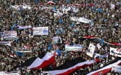 Thousands of Yemenis protest year-long coalition campaign
