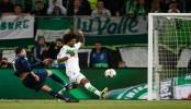 Wolfsburg upset Real 2-0