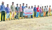 Farmers of Halti Beel area form a human chain