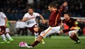 Totti magic saves Roma