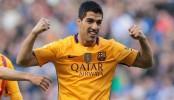 Suarez scores 4 goals as Barcelona wins 8-0 to keep its lead