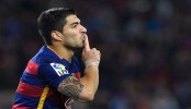 Suarez keeps Barca on top
