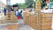 Fish-traps are brought for sale in a market