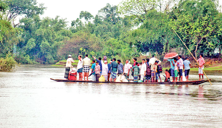 Traditional boat ferries passengers risking their life