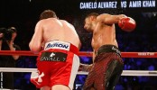 Boxing: Canelo Alvarez retains world title against Amir Khan