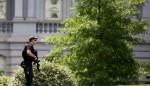 Armed man shot outside White House