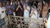 Khaleda offers fateha at husband, son's graves