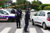 Officials: French police commander slain by jihadi recruiter