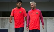 Messi shows off new look at Barcelona camp in England