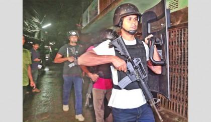 Militants' den busted in city, nine killed