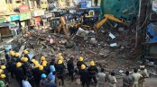 8 dead, several feared trapped as building collapses near India's Mumbai