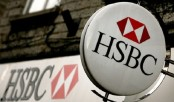HSBC profits slide amid 'turbulent period'