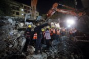 Several feared trapped under debris after building collapse in India